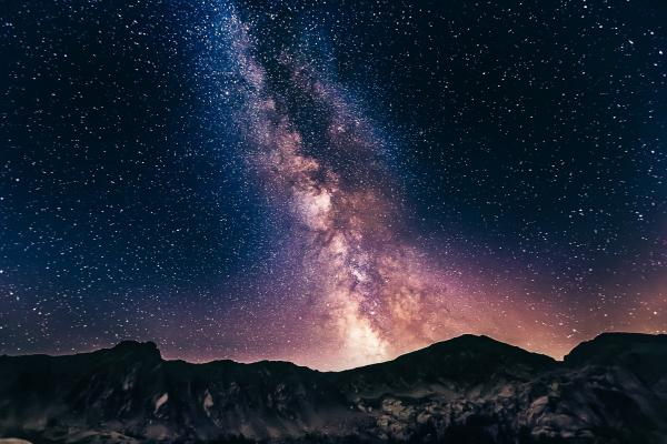 Image of the Milky Way stretching above a mountain range.