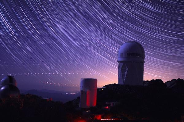 image of an observatory with a starry sky backdrop.